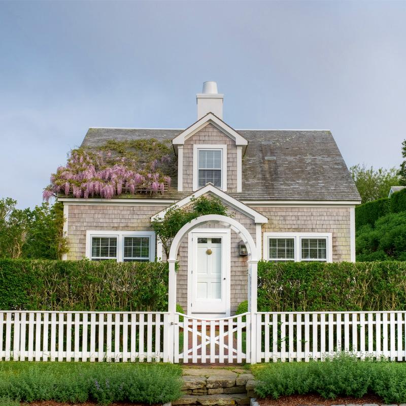 Cobble Hill House, built in classic Nantucket gray cedar shingle. Photography by Greg Hinson
