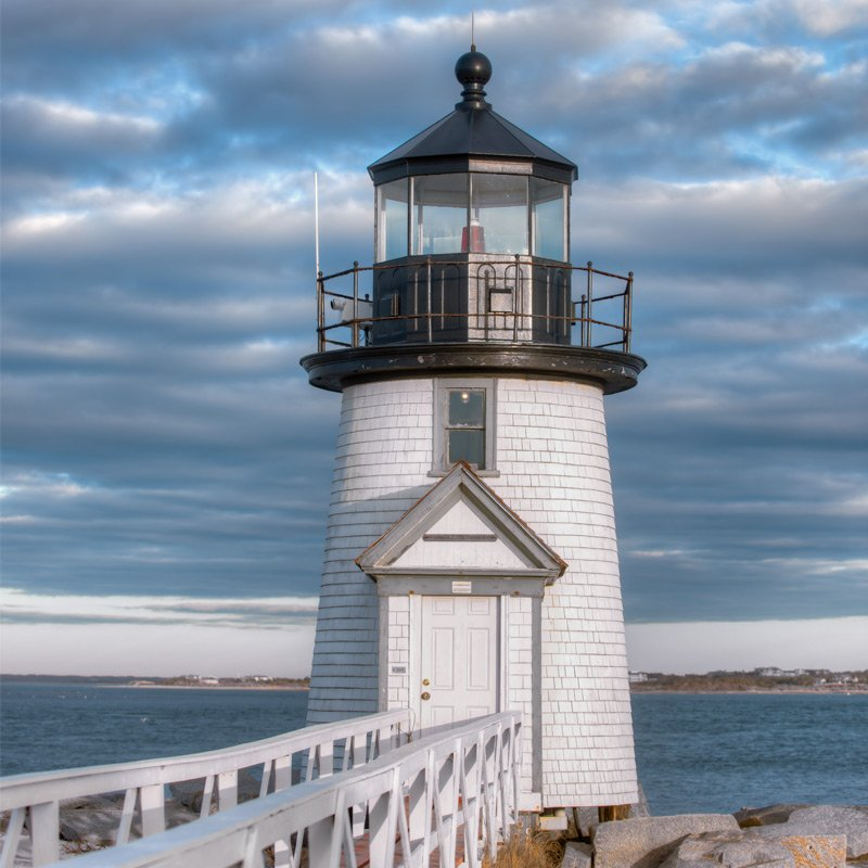 Brant Point Lighthouse at the entrance to Nantucket Harbor. Photography by Greg Hinson