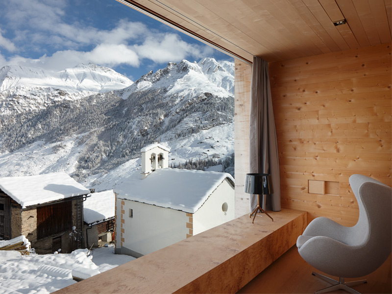 In this modern ski lodge, high in the hills above Vals, the award-winning Swiss architect Peter Zumthor has created a breathtaking interplay between modern design, natural finishes and spectacular views. Photograph: Ralph Feiner. Copyright: Zumthor Ferienhäuser Leis