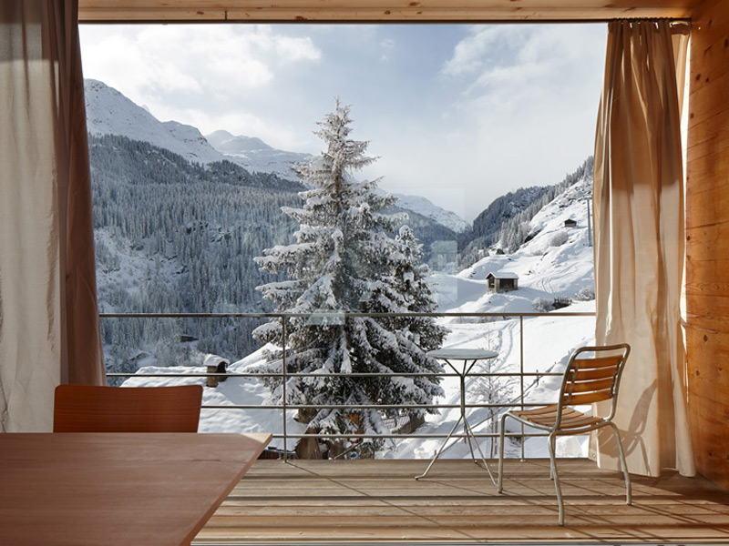 Small chalet windows have been replaced with sweeping panoramas in new loft-style interiors. Photograph: Ralph Feiner. Copyright: Zumthor Ferienhäuser Leis