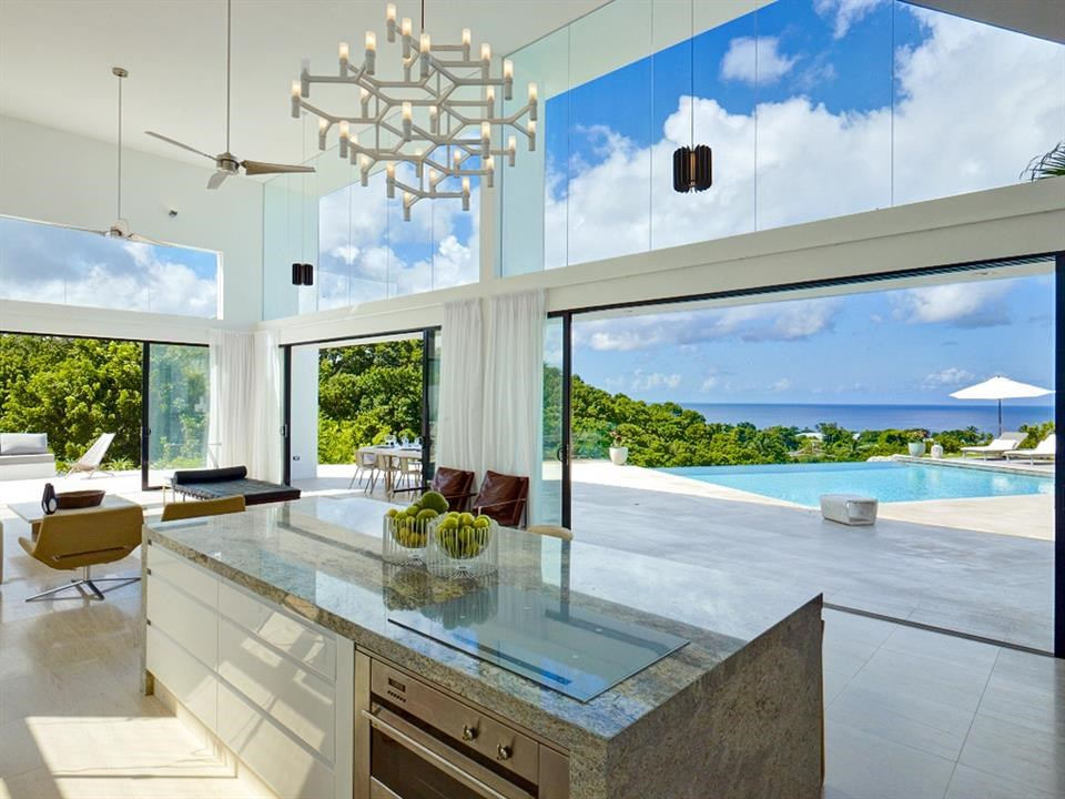 <strong>4 Bedrooms, 4,330 Sq Ft.</strong><br/>This stylish and newly built contemporary 4 bedroom villa sits on a ridge and boasts magnificent sea views over an impressive gully, which can be enjoyed from an inviting infinity edge pool.