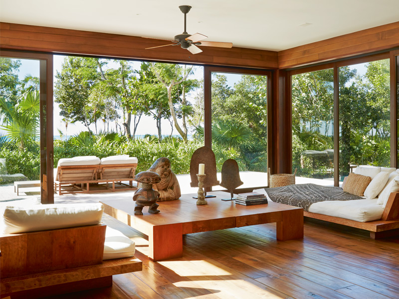 Floor-to-ceiling windows unite the tropical gardens with the pared-down interior. Photograph: Ngoc Minh Ngo