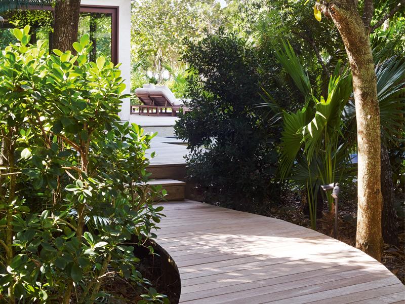 The work of Singapore-based architect Cheong Yew Kuan and New York's Bonetti/Kozerski Studio, the villas feature polished ipe-wood terraces and pathways. Photograph: Ngoc Minh Ngo