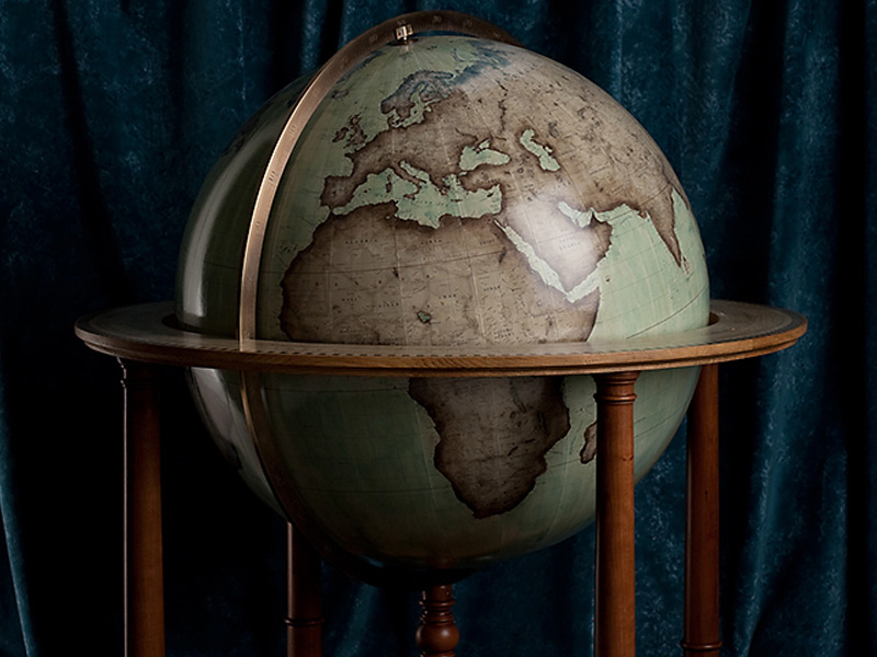 Bellerby & Co.'s Galileo globe is based on the famous Blaeu globe, with an updated map. Photograph: Ian Nolan. Stylist: Sophie Martell. Fabric: Molano velvet in teal, Designers Guild