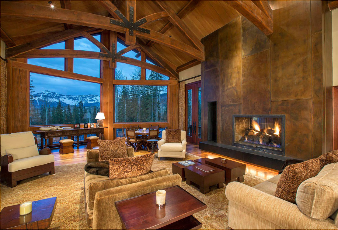 High Country Chateau captures the essence of the rugged American West combined with Colorado mountain luxury. The great room features a massive stone fireplace and 25 foot vaulted ceilings with handcrafted, Douglas Fir beams and trusses.