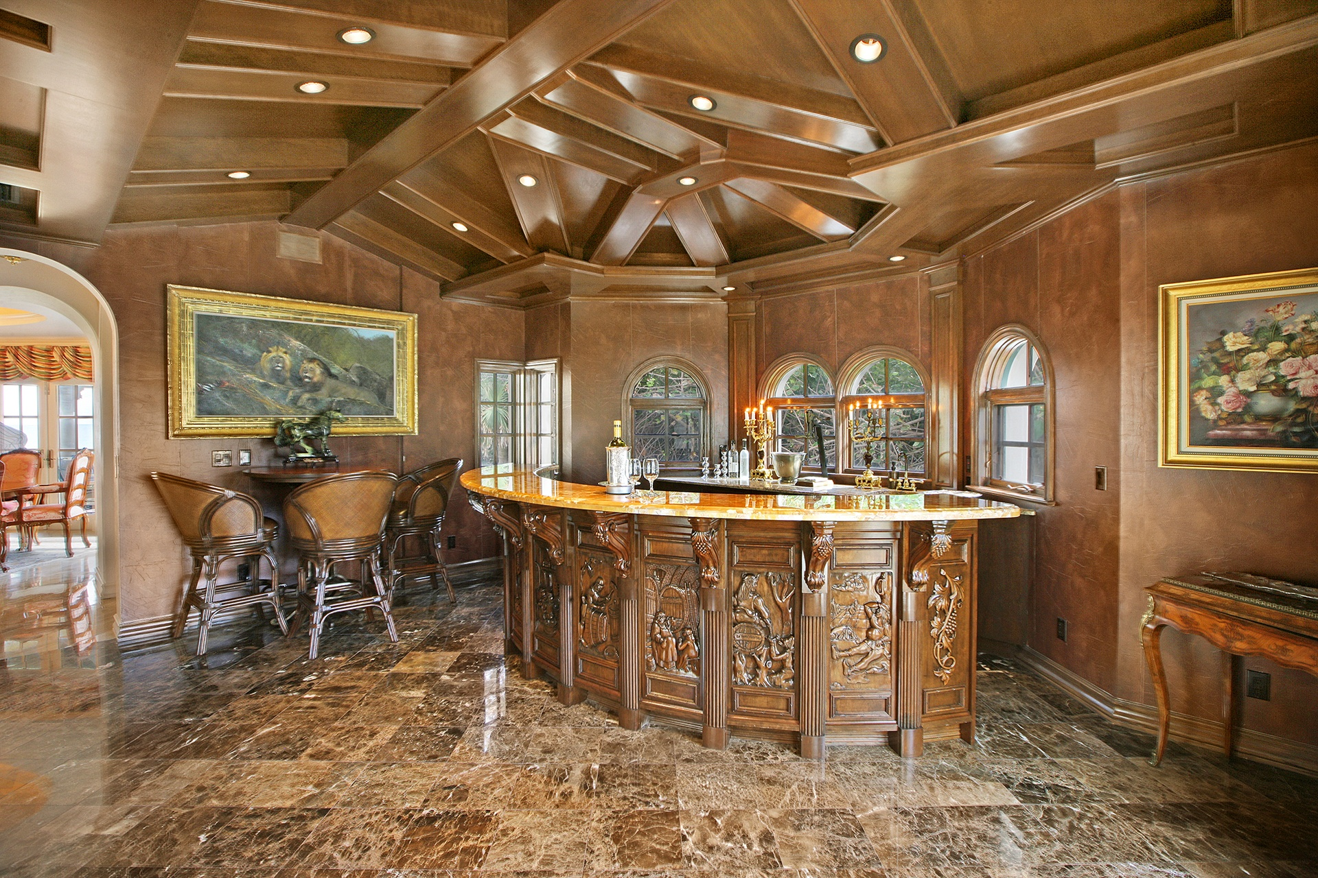 A fully equipped wet bar with views of the Atlantic Ocean and the moonscapes for which it was named is just one of the luxurious features of this Mizner-esque mansion on the sands of Jupiter Island, Florida.