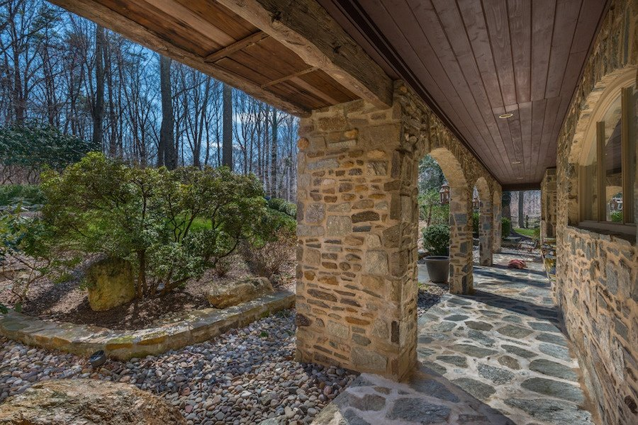 This Western Craftsman-style home is built for outdoor living with its expansive deck and wooded lot.