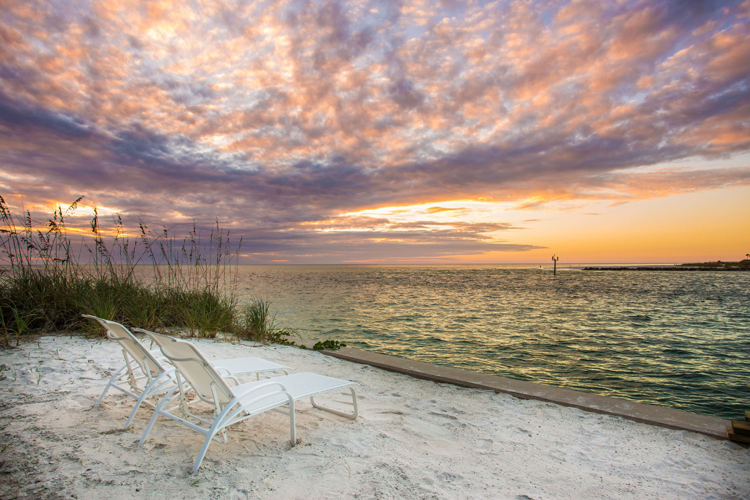 Unparalleled views of the Gulf are enjoyed from almost every room of this cheerful residence located only four and a half miles from Sarasota.