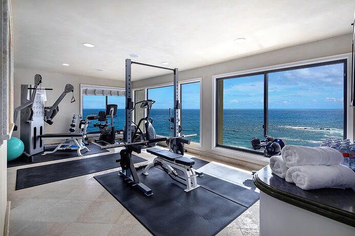 Panoramic ocean views and state-of-the-art amenities for health and fitness, including a gym, steam room, and sauna, are among the highlights of this waterfront retreat in Laguna Beach.