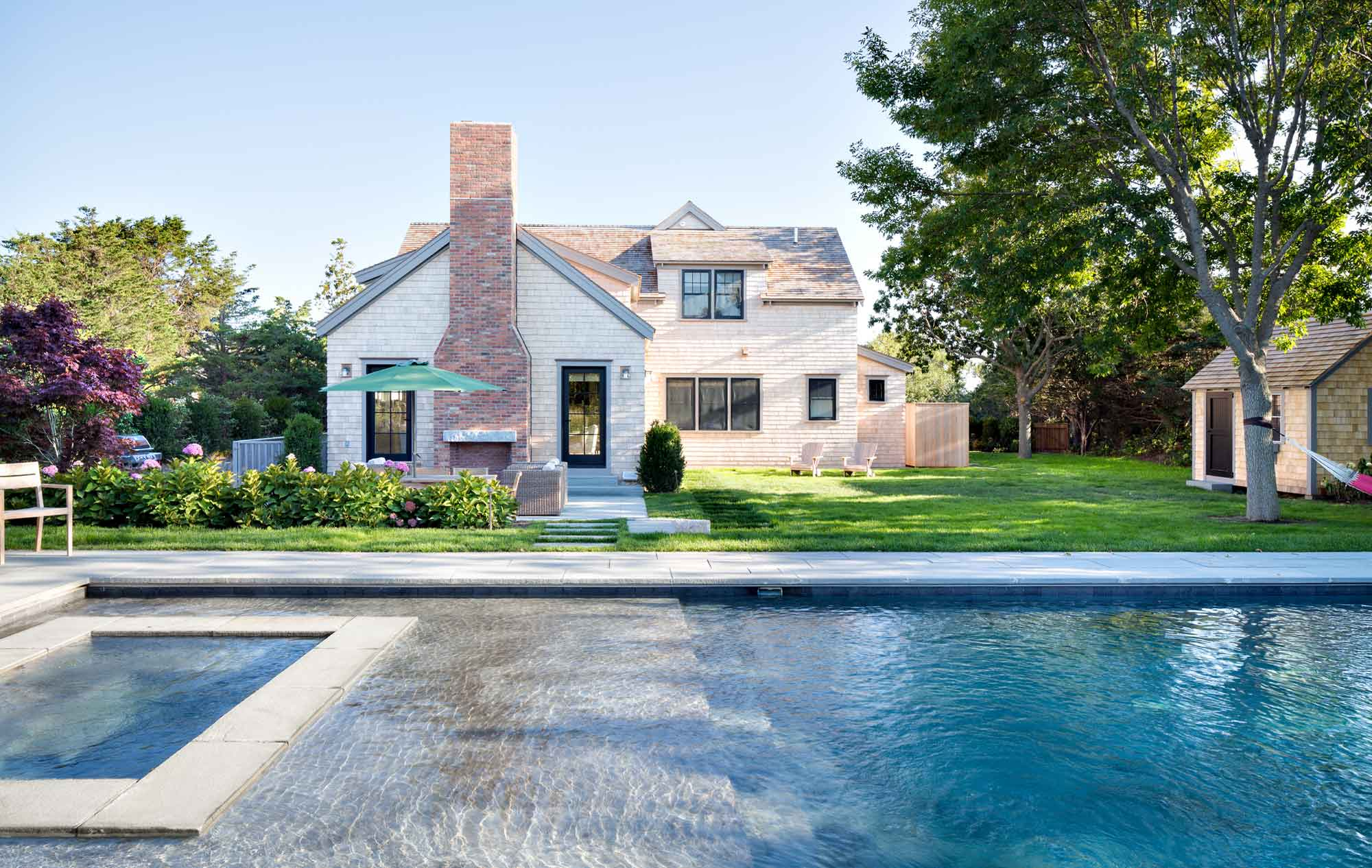 This modern Nantucket farmhouse compound in the quiet neighborhood of Old Westmoor Farm has been thoughtfully designed and masterfully executed, offering six bedrooms and 7,500 square feet of living space across three floors.