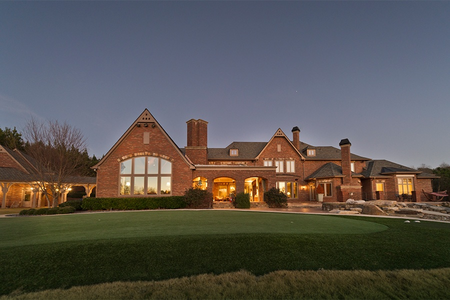 The facade of Smoltz's 10-bedroom Milton, Georgia, residence is clad in warm-hued brick, and features Craftsman-style carved wood details.