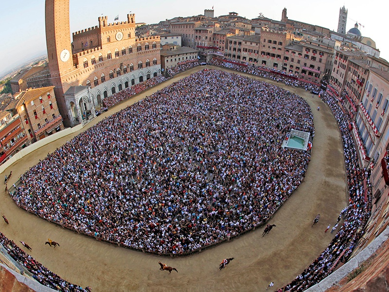 Perhaps Italy's most famous sporting event, the Palio di Siena is a thrilling bareback horse race that lasts, on average, just 75 seconds. Around two thirds of the Sienese population attends the much-anticipated event. Banner image: The Prix de Diane race at Chantilly Racecourse, France.