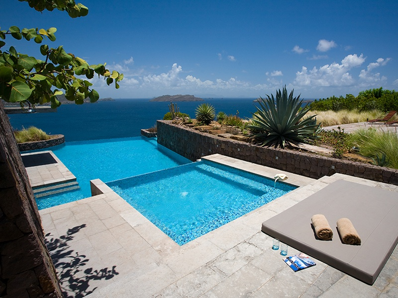 Modern design, landscaped gardens, and a stunning infinity pool add to the appeal of Villa Six.