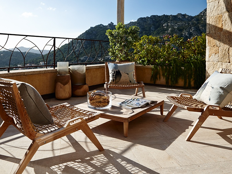 Warm, earthy colors in the expansive outdoor living areas are joined by natural materials that have been given a modern twist.