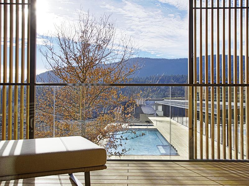 Lanserhof Tegernsee's Parvus suite is spacious lounge/bedroom combination overlooking the heated saltwater pool and Bavarian countryside. Photograph: Egbert Krupp