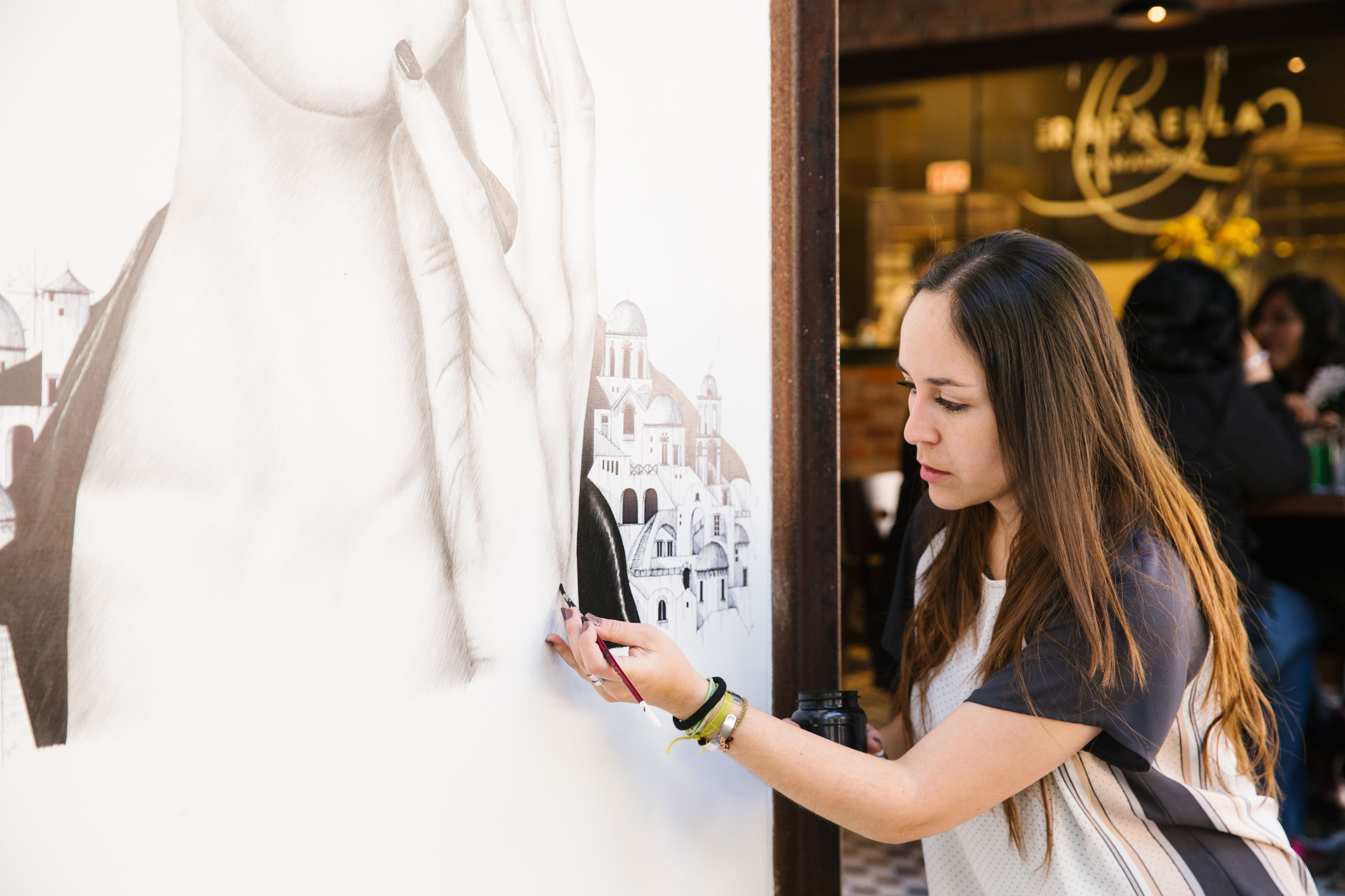 """Working outside is, says Avila, """"a very enriching experience because of the interaction between artist and public."""" Photograph: Jessica Sample"""