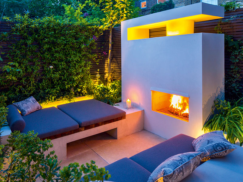 Stylish outdoor fireplaces are among the features encouraging people to use their gardens all year round. Photograph: Marianne Majerus/Design: Charlotte Rowe
