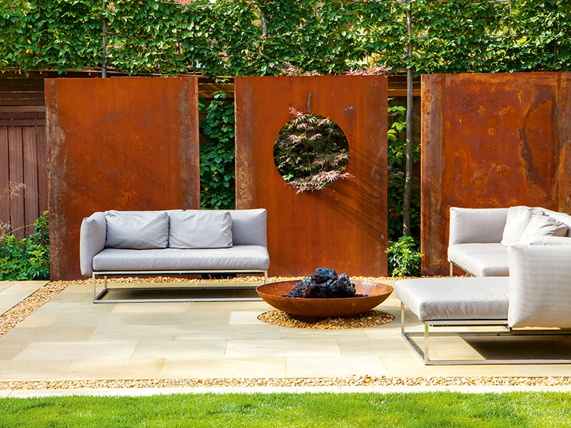 Rusted metal is a popular accent in our green spaces, often as freestanding sculpture. Photograph: Marianne Majerus/Design: Sara Jane Rothwell. Banner image: Shapely shrubs are particularly effective in urban gardens. Photograph: Marianne Majerus/Design: Sara Jane Rothwell