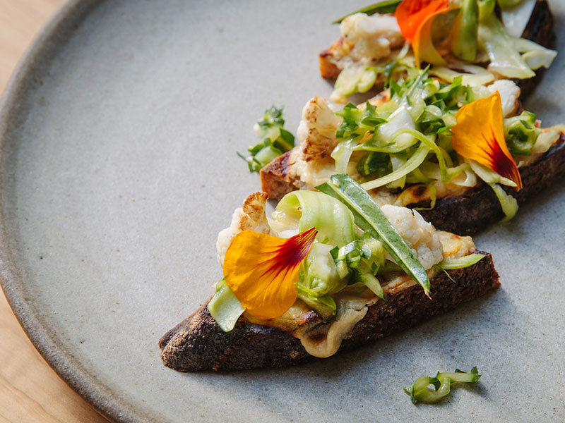 Head chef Chris Kiyuna strikes a balance between sophistication and satisfaction, with the changing menu showcasing produce from the restaurant's living pantry. Photograph: Alanna Hale