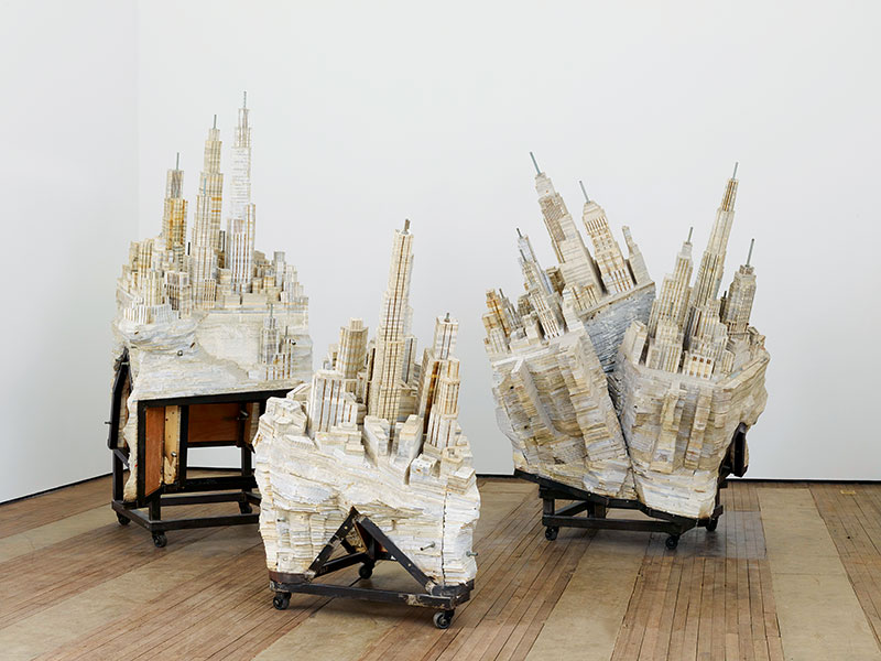 Urban architecture is a recurring thread in Liu Wei's work. In <i>Library II-II</i> (2013), fortress-like cities made of carved books appear to be splitting apart. Photograph: Courtesy of Liu Wei and Lehmann Maupin, New York and Hong Kong