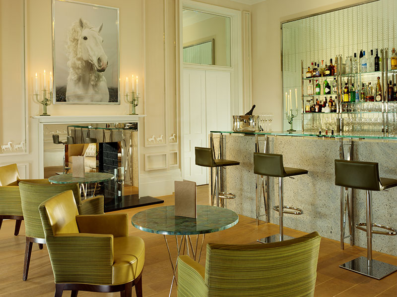 Hulbert's designs, like this bar at Coworth Park hotel, always start by listening to what clients like. The next step is to consider the project's location, character, and history. Photograph: Coworth Park