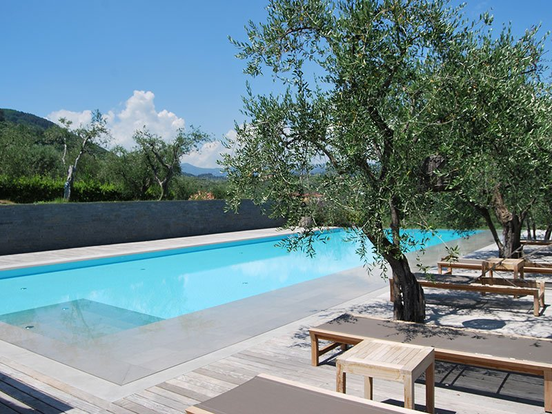 Hulbert's designs for a private Tuscan villa in Italy incorporated the work of local artisans, and also locally sourced materials, such as the stone for this stunning swimming pool. Photograph: Villa Emma