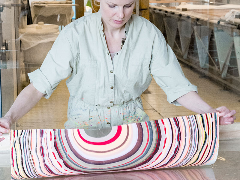 Pernille Snedker Hansen, founder of Copenhagen's Snedker Studio, uses a process inspired by a traditional Japanese technique called <i>suminagashi</i>. Banner: Hansen is also influenced by parquet floors and the geometry that defines the way they are laid.