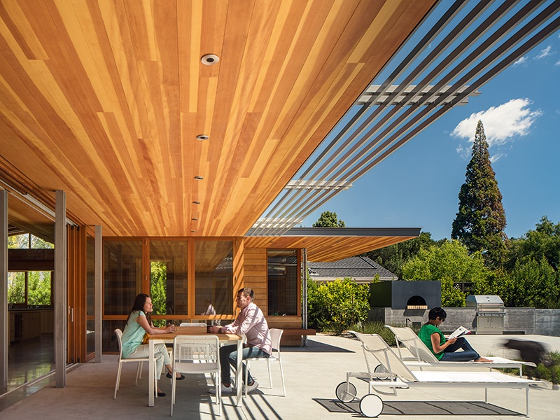 Woods, including Douglas fir, western red cedar, and gray elm, provide Los Altos Residence a sense of warmth and continuity with the outdoors. Photograph: Nick Lehoux