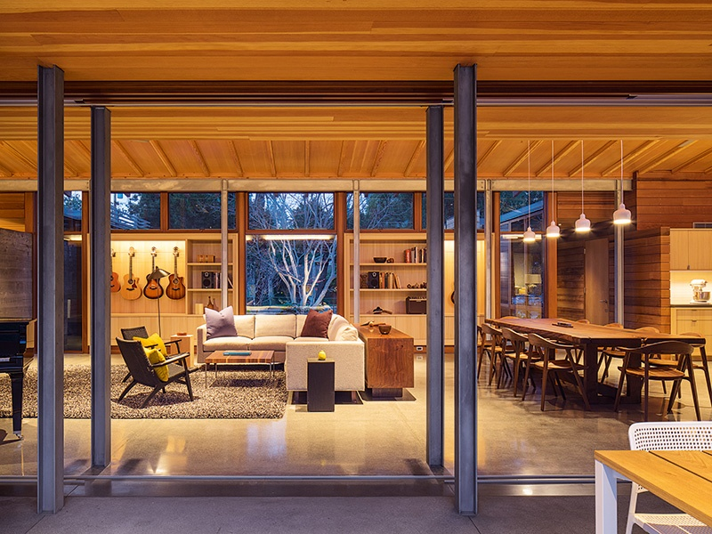 A 10-foot table made from locally sourced Claro walnut is the centerpiece of the Los Altos Residence's dining space. Photograph: Nick Lehoux