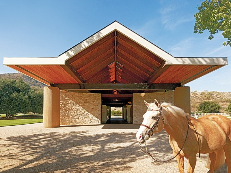 Stone Canyon Ranch's state-of-the-art equestrian facility comprises five stables, a hay barn, two riding arenas, and two training arenas.