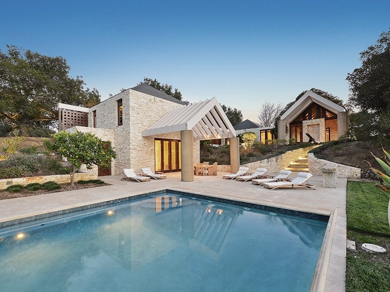 In another supreme example of a modern Californian ranch, Stone Canyon Ranch's incorporation of solid, natural materials, including a French slate roof, Italian limestone flooring, and Alaskan cedar trellises, complements spectacular natural surroundings.