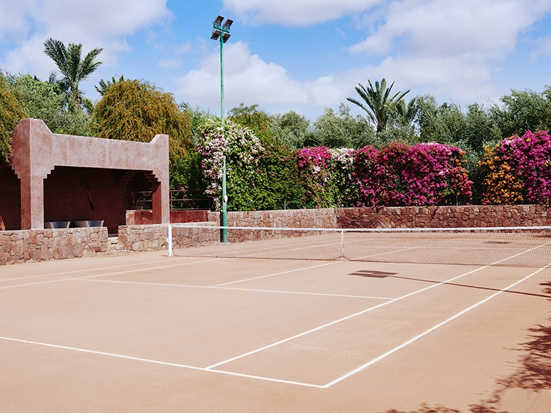 The estate's red-clay court is reminiscent of Roland Garros in Paris. Photograph: Kensington Luxury Properties