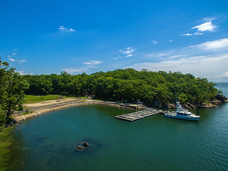 In addition to the yacht basin and large dock, the property includes a boathouse for winter storage.