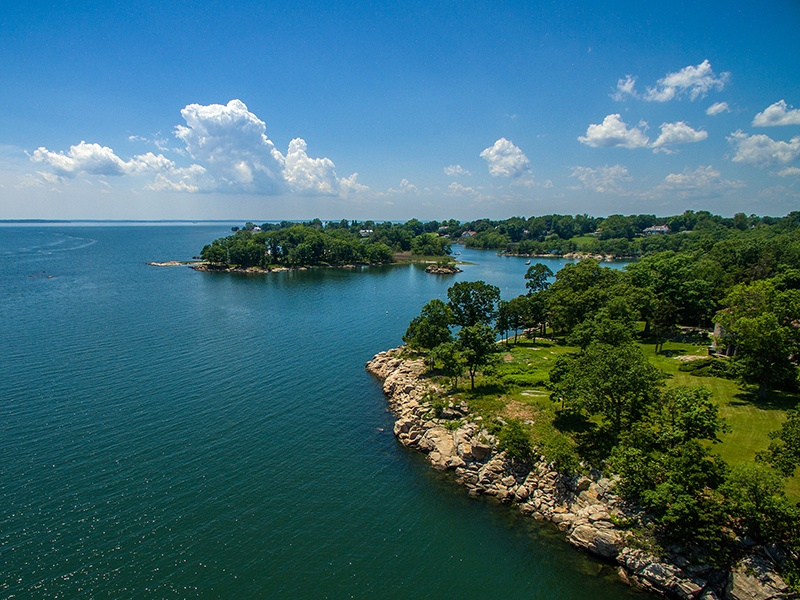 The Great Island estate is surrounded by water, with its inhabitants enjoying considerable seclusion while also being within an hour's traveling time to New York City.