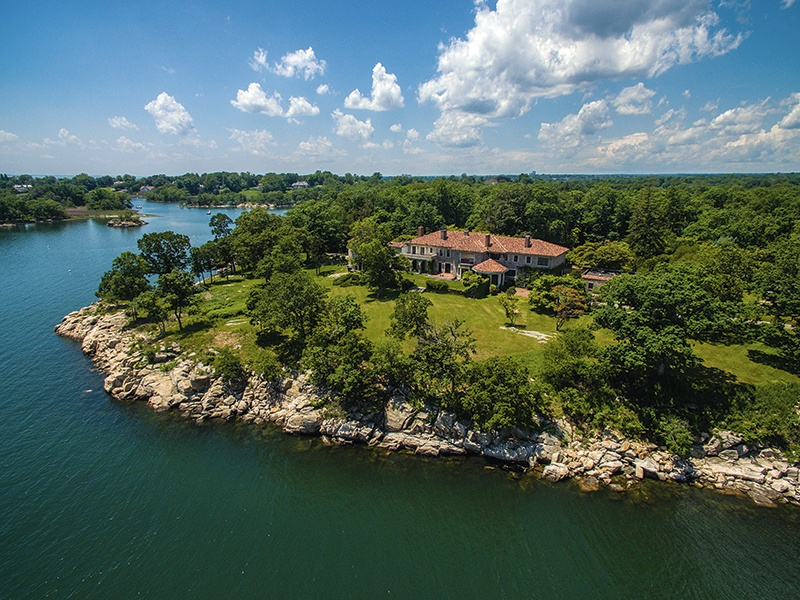 The 63-acre Great Island estate enjoys superb views across the Sound to the Long Island shore. The property is connected to the mainland by a wide land bridge.