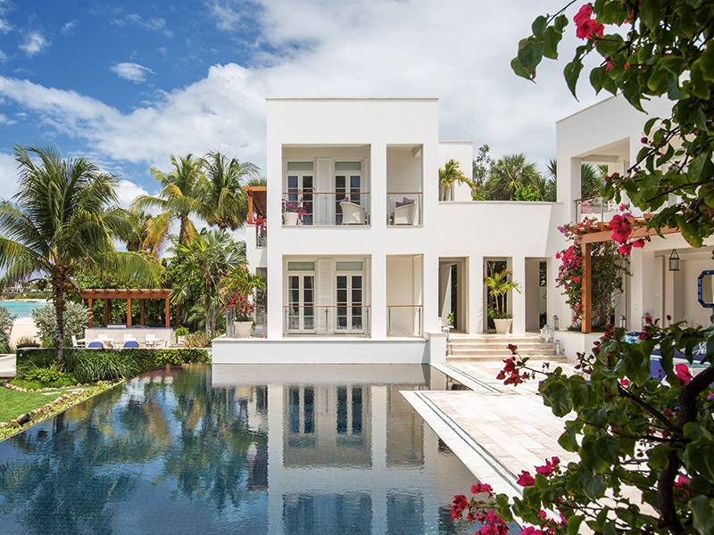 Cerulean Villa in the West End of Anguilla exemplifies the best of modern waterfront living while embracing the lush landscape of the island. Photograph and banner image: Laura Moss