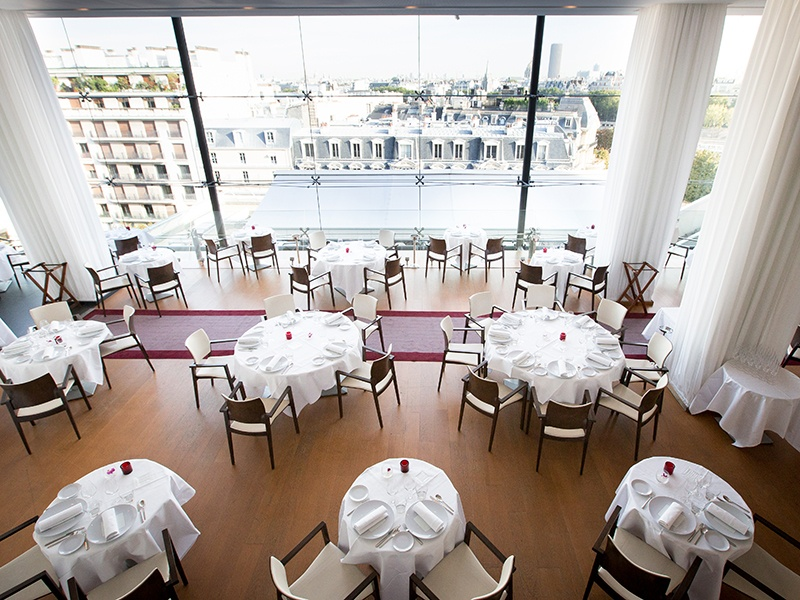 Guests of Maison Blanche's immaculate dining room will enjoy Chef Fabrice Giraud's menu, which incorporates Mediterranean flavors, and an extensive wine list. Photograph: Patrice Lariven