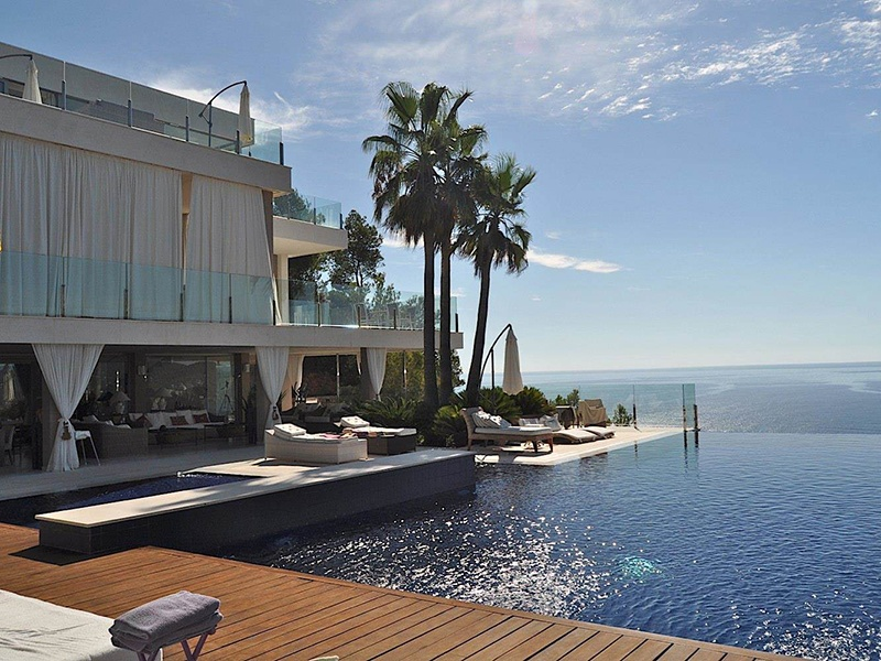 The spacious terraces and porches of this Cala San Vicente villa provide soaring views over the bay. Photograph: Estela Exclusive Homes