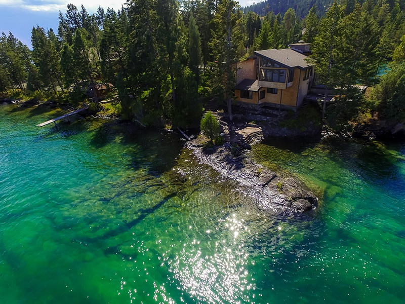 Enjoy four secluded acres and 2,500 feet of shoreline at the seven-bed, seven-bath Jewel of Flathead Lake property. Photograph: PureWest Real Estate