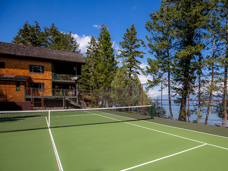 Be one with nature as you play on the immaculate full-sized tennis court, which blends seamlessly with its surroundings. Photograph: PureWest Real Estate