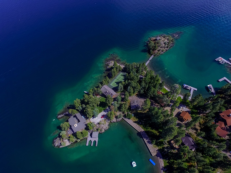 This waterfront estate offers the best of lakefront living—a private island offers a panoramic view. Photograph: PureWest Real Estate