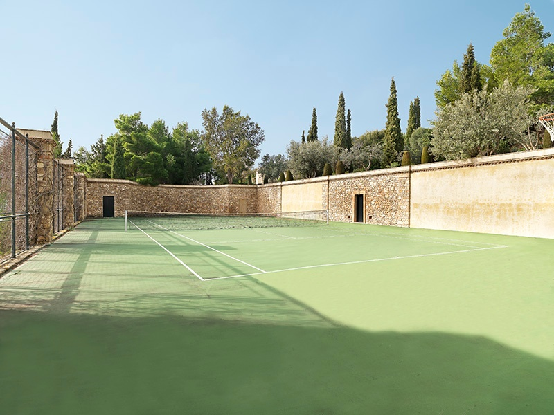 The tennis court of this Mediterranean estate continues the tranquil atmosphere evident throughout the property. Photograph: Ploumis Sotiropoulos