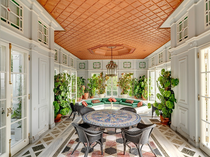 The interior of this Provençal-style home on the outskirts of Athens is bathed in warm light thanks to large windows overlooking the pristine gardens. Photograph: Ploumis Sotiropoulos