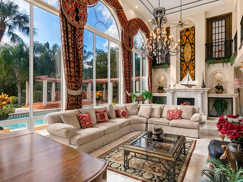 This interior of this 4,742-square-foot home features gilded Corinthian columns and decorative ironwork. Photograph: Regal Real Estate Professionals