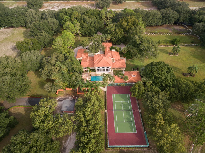 Amid 152 acres of lawns, paddocks, and pastures, this well-proportioned equestrian estate is also equipped with a pool and tennis court. Photograph: Regal Real Estate Professionals