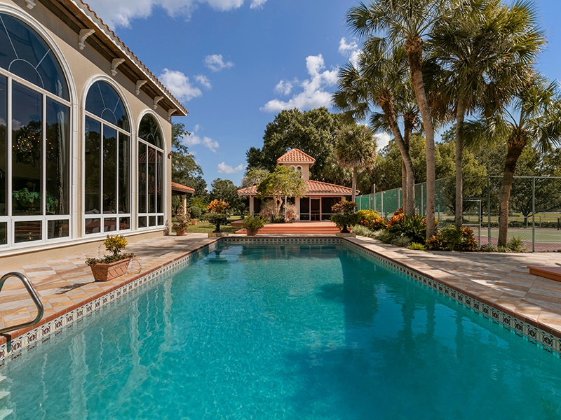 The pool, tennis court, terrace, and summer kitchen offer plenty of opportunities for entertaining and al fresco dining. Photograph: Regal Real Estate Professionals