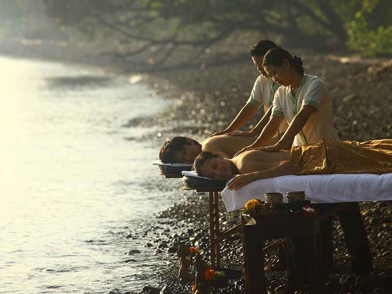 Some of Spa Village Resort Tembok's treatments are conducted outdoors, with the Balinese sky above and sea beyond.