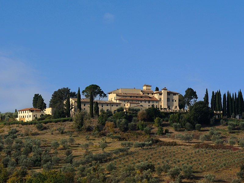 Castello del Nero is surrounded by the rolling hills of Tuscany, planted with grapes, herbs, and olives that are harvested for use in the hotel's restaurant and spa.