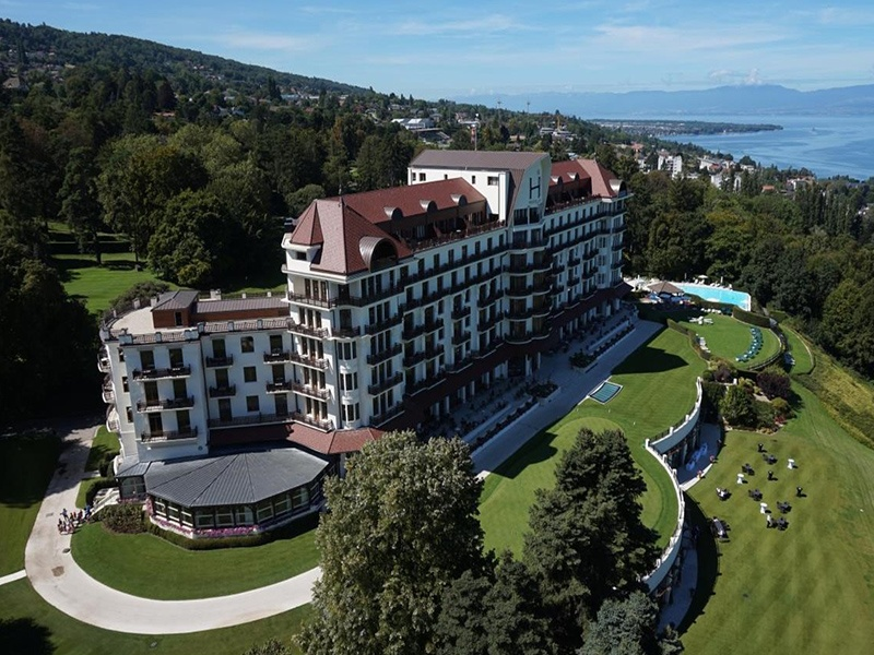 Not far from Hôtel Royal in Évian-les-Bains is the Cachat Spring, the source of Evian natural mineral water, renowned for its healthful properties since 1789. Banner image: The pool at Hôtel Royal, which looks out towards Lac Léman.