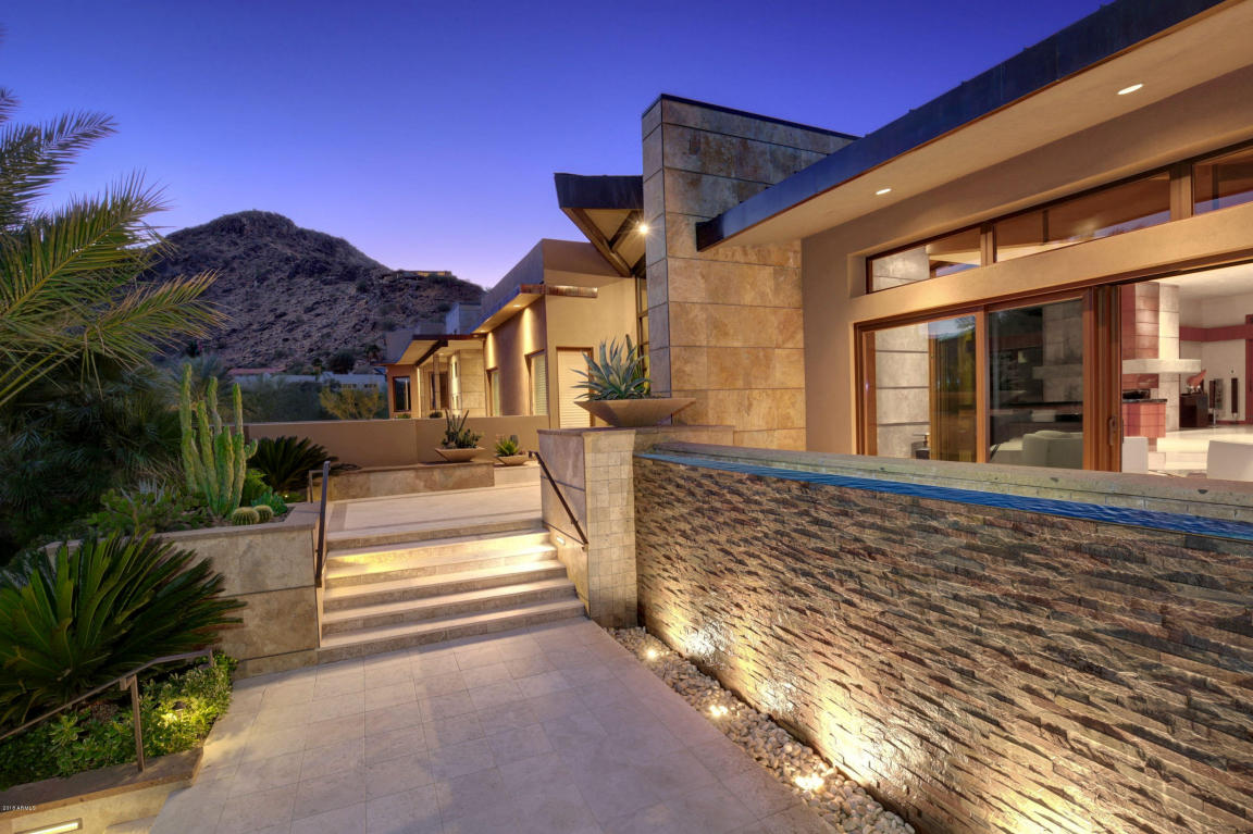 Frank Lloyd Wright would approve of the bold lines, ingenious use of stone, brick and wood, and fluid indoor-outdoor spaces of this modernist structure, which is beautifully integrated into the desert landscape.